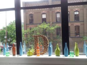 Windows were filled with colored wine bottles and mixed with our initials.